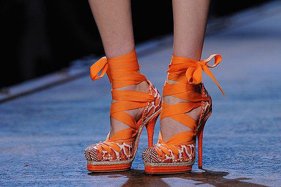 orange high heels imagine zero. Black Bedroom Furniture Sets. Home Design Ideas